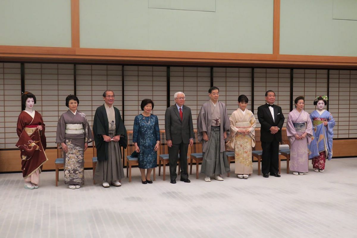 (Fourth and fifth from left) Mrs and Dr Tan attending a welcoming ceremony at the Kyoto State Guest House on Dec 2, 2016. Standing next to Mrs Tan are Kyoto City Mayor Daisaku Kadokawa and his wife. Standing next to Dr Tan are Mr Yamada and his wife,