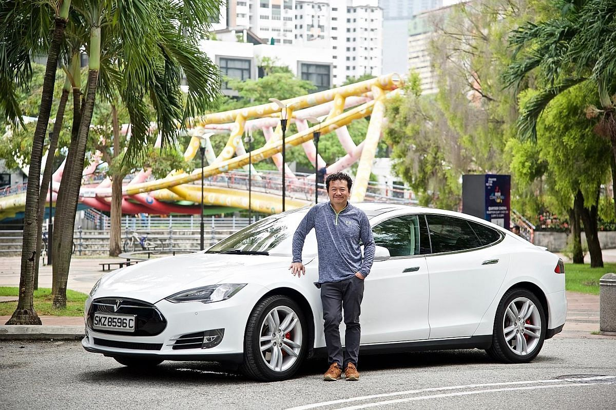 Mr Eu Pui Sun (left) has been driving a test- bed Mitsubishi i-MiEV since 2011. Mr Joe Nguyen imported a used Tesla Model S P85 from Hong Kong last year. Dr Karen Soh drives a BMW i8, a $580,000 plug-in hybrid electric coupe.