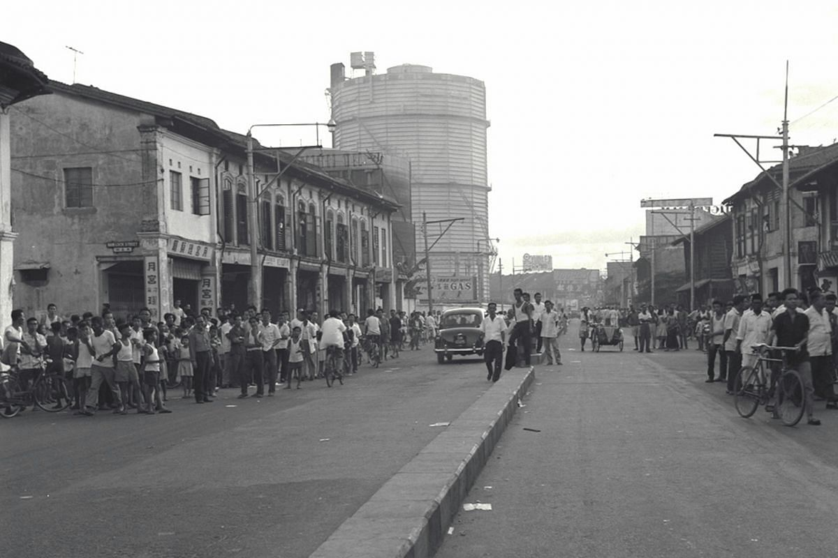 A trouble spot in Geylang in 1964 when rumours helped spark an angry chain reaction among different races that led to 36 deaths during the racial riots which broke out that year.