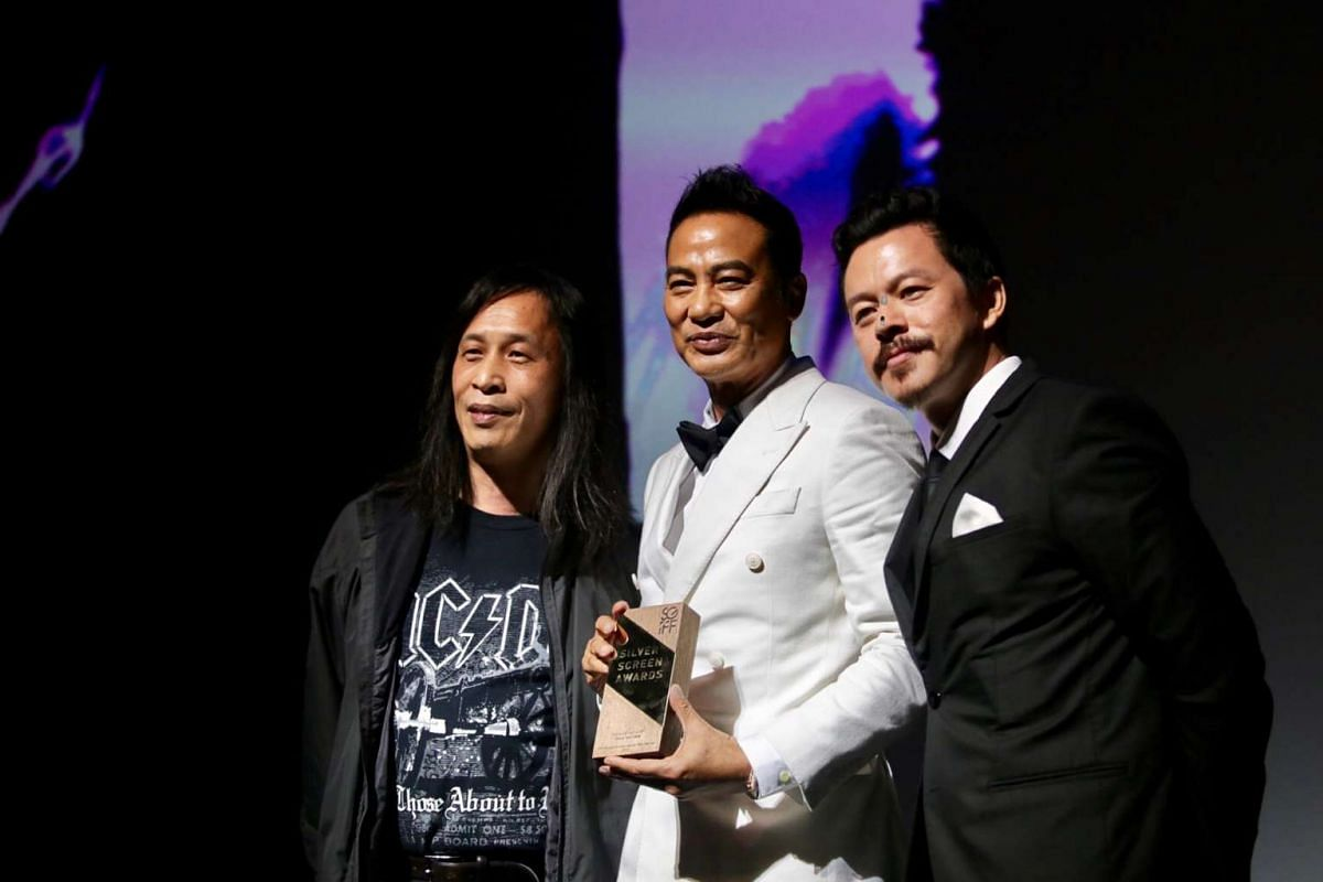 Actor Simon Yam receiving the Cinema Legend Award from director and scriptwriter Herman Yau (left) and Singapore International Film Festival chairman Mike Wiluan.