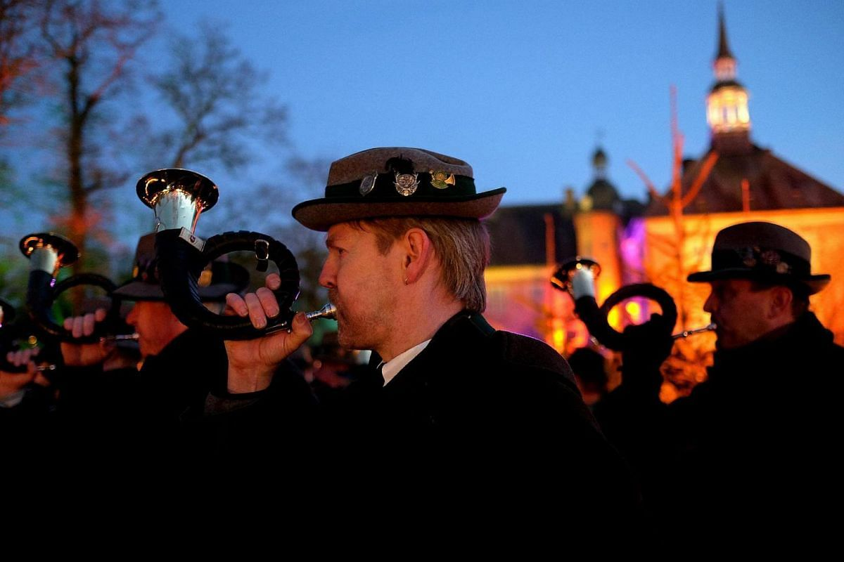 Men blowing the hunting horn at the annual Christmas Market at the castle of Goedens in Sande, Germany, on Nov 27, 2016.