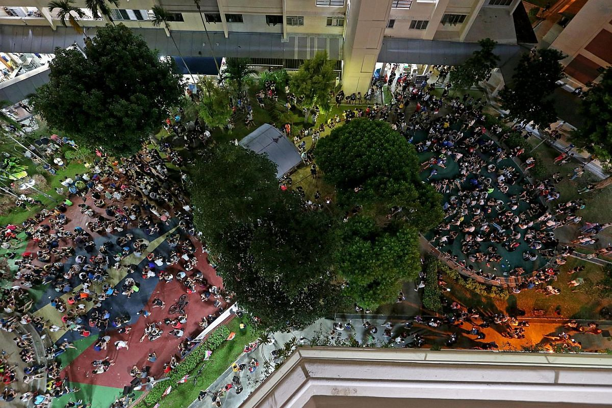 Pokemon Go players gathered in front of Block 401, Hougang Ave 10 on Aug 13, 2016.