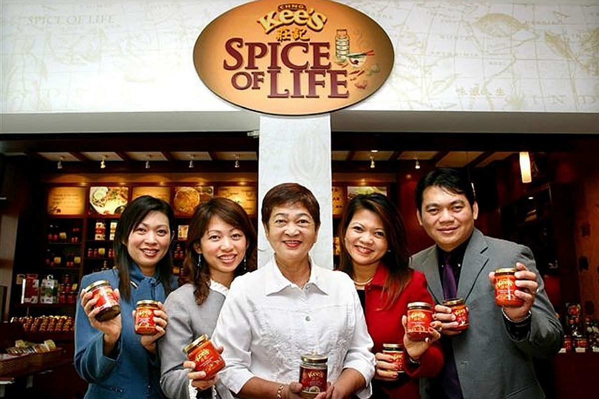My life so far: Ms Chng (second from right) with her mother (centre) and siblings, (from left) Kathleen, Claire and Wilfred, at the opening of Sin Hwa Dee's sauce boutique on Sentosa in 2005.