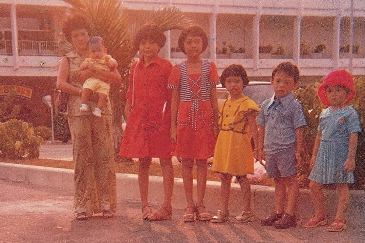 My life so far: Ms Jocelyn Chng (fourth from left) with her mother, Madam Tan Hwee Hwang, and siblings (from left) Tony, Kathleen, Claire, Wilfred and Cheryl on an outing to Haw Par Villa in 1977.