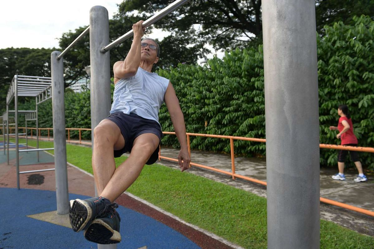 Ngai doing a one arm pull-up at Toa Payoh Stadium where he does regularly to work out and practise his calisthenic moves.