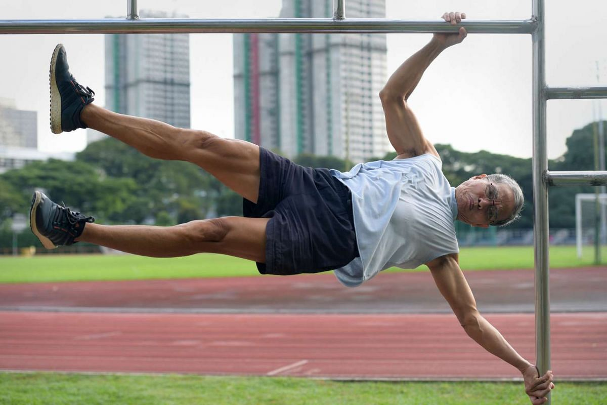 Mr Ngai Hin Kwok attempts an advanced calisthenic move, the human flag, at an exercise corner at Toa Payoh Stadium. The 67-year-old is a member of Team Strong Silver, a group of seven fitness enthusiasts with an average age of 68 years. They promote