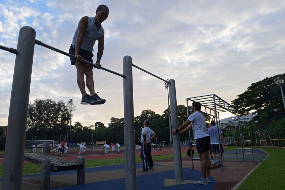 Ngai, who weighs 58kg, doing muscle-ups at Toa Payoh Stadium where he goes sometimes in the mornings to practise his calisthenic moves. Passers-by occasionally stop to watch him and some have expressed concern that he should not be engaging in such e