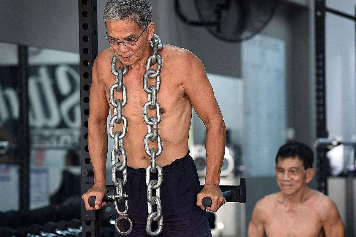 Mr Ngai at home in the middle of his daily exercise routine. He does 80 to 200 push-ups and the same number of squats every morning. He repeats the set at night if he has the time. The active senior lives with his wife and has two sons.