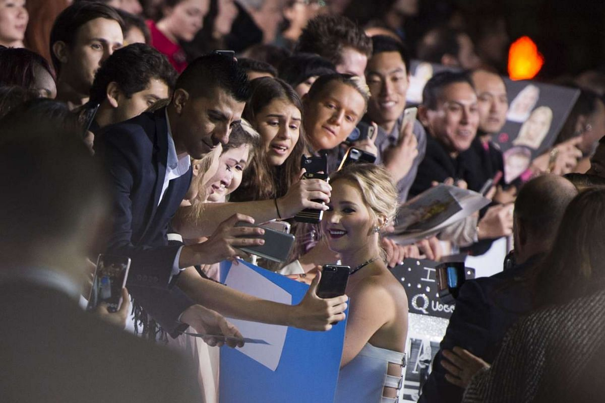 Actress Jennifer Lawrence with fans at the Passengers premiere in Westwood, California, on Dec 14, 2016.