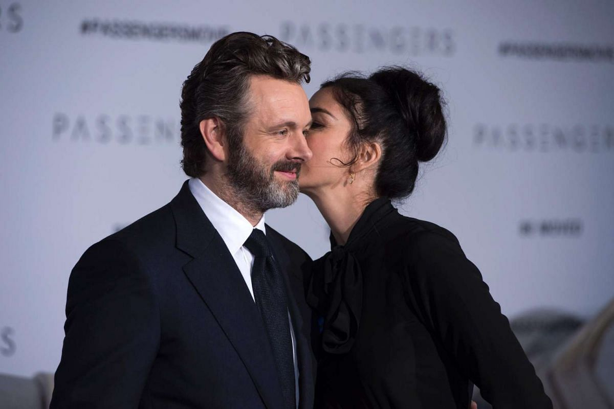 Actor Michael Sheen (left) and his partner, comedian Sarah Silverman, at the Passengers premiere in Westwood, California, on Dec 14, 2016.