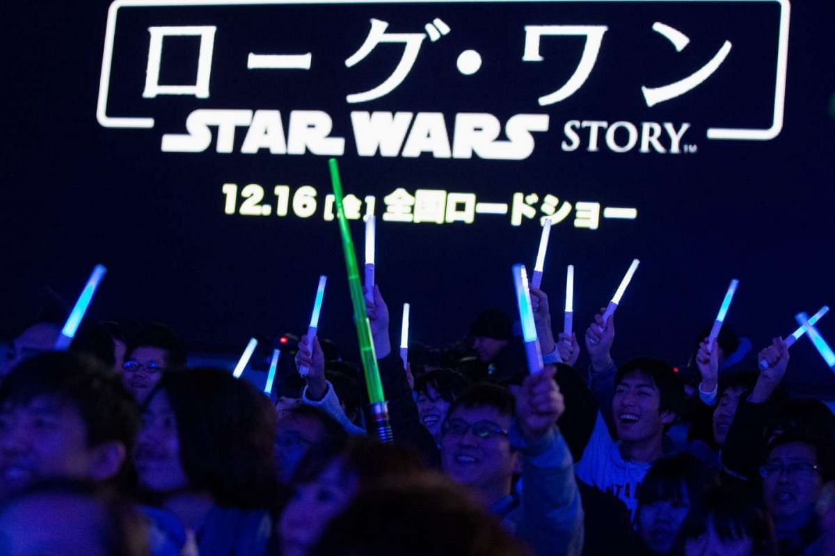Excited fans waving their lightsabers at the Japan premiere of Rogue One: A Star Wars Story in Tokyo on Dec 8, 2016. The film opens across Japan on Dec 16, 2016.