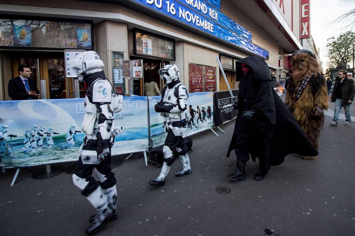 In real life, they're all buddies just heading to the Grand Rex cinema in Paris, France, on the first day of the European release of Rogue One: A Star Wars Story on Dec 14, 2016.