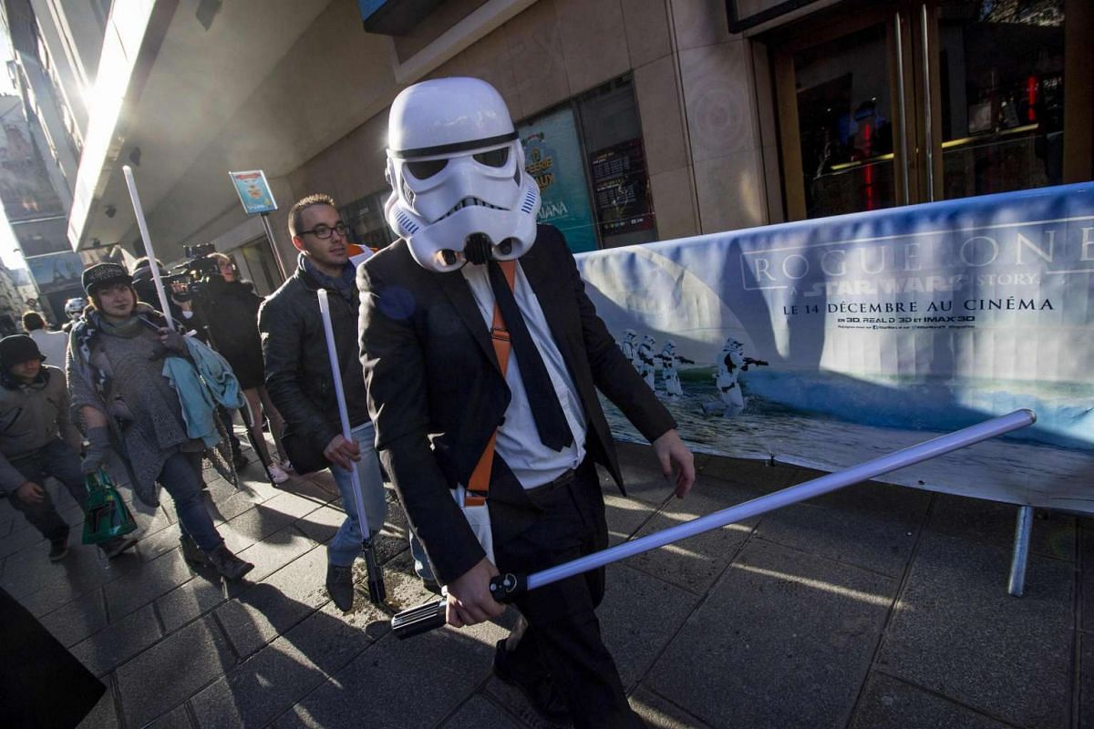 A yuppie Stormtrooper arriving at the Grand Rex cinema in Paris, France, on the first day of the European release of Rogue One: A Star Wars Story on Dec 14, 2016.
