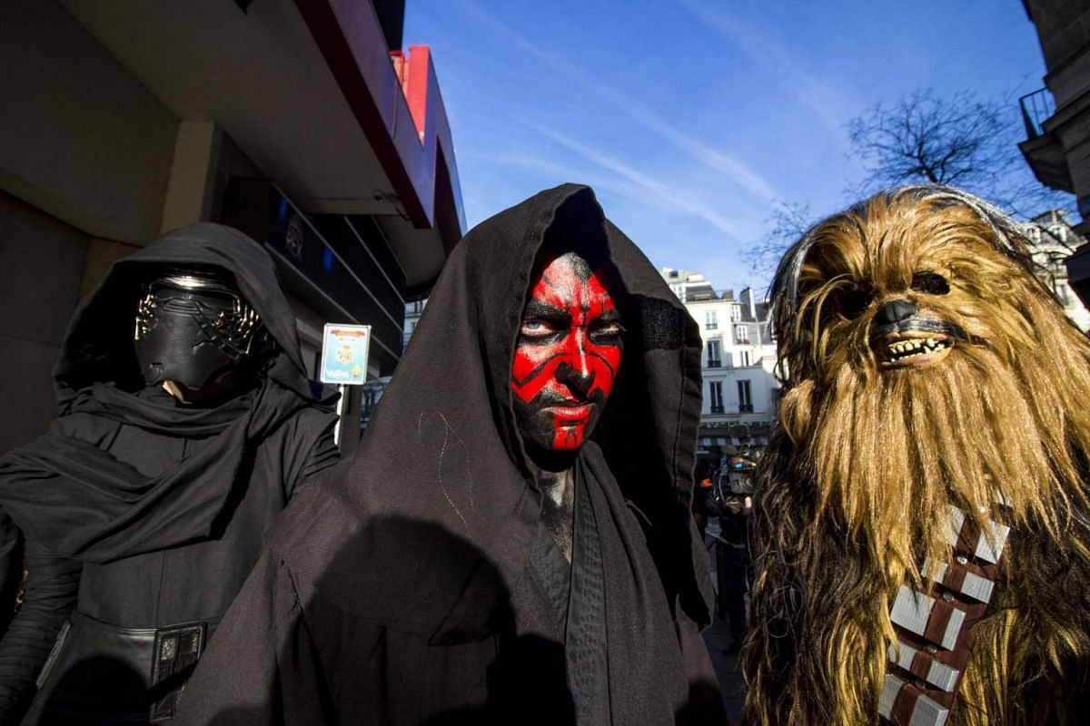 Fans dressed as Kylo Ren, Darth Maul and Chewbacca at the Grand Rex cinema in Paris, France, on the first day of the European release of Rogue One: A Star Wars Story on Dec 14, 2016.