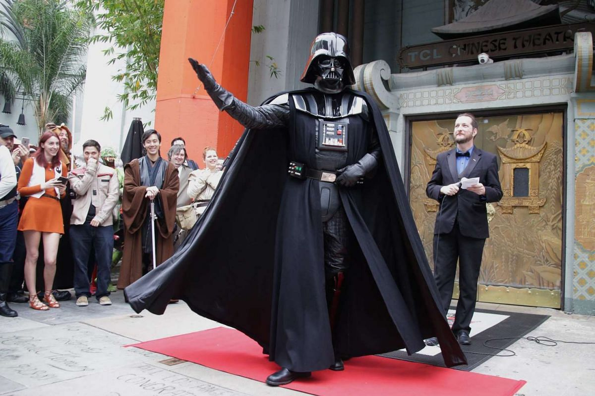 A fan dressed as Darth Vader posing for a costume contest prior to the screening of Rogue One: A Star Wars Story at the TCL Chinese Theatre in Hollywood, California, on Dec 15, 2016.