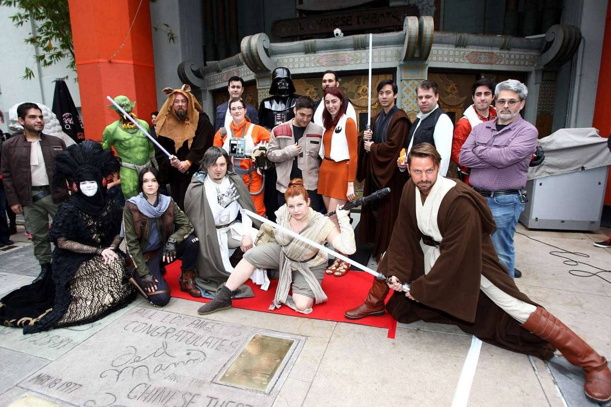 Fans posing for photos while lining up to catch Rogue One: A Star Wars Story at the TCL Chinese Theatre in Hollywood, California, on Dec 15, 2016.
