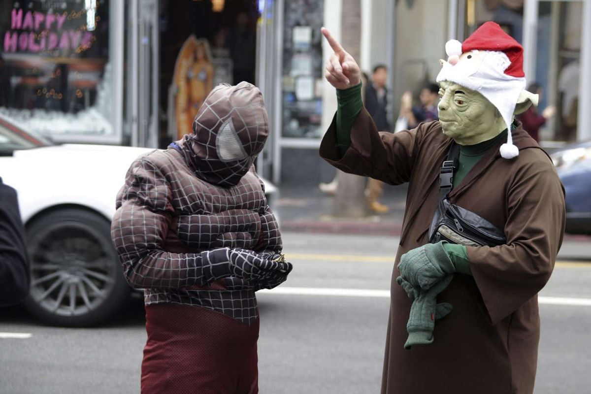 Among the Star Wars fans in costume, there's a Spider-Man hanging out with Yoda outside the TCL Chinese Theatre in Hollywood, US, on Dec 15, 2016.