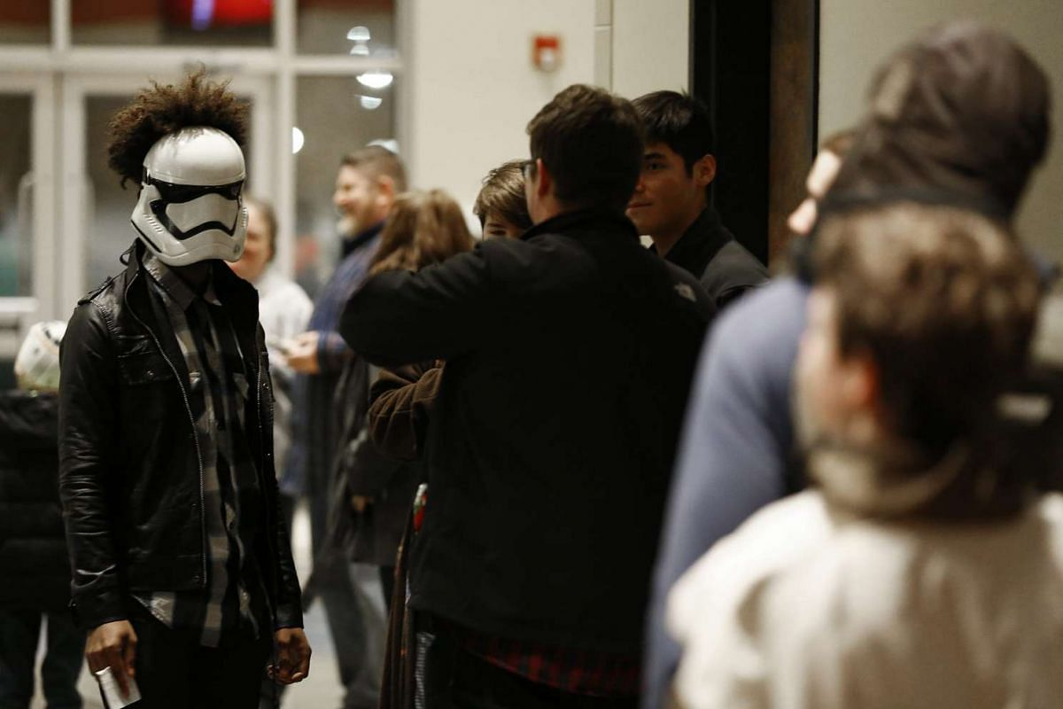 No lightsaber? Then a Stormtrooper mask will do for this fan joining others at the opening of Rogue One: A Star Wars Story at the Trans Texas Theater in the US on Dec 15, 2016.