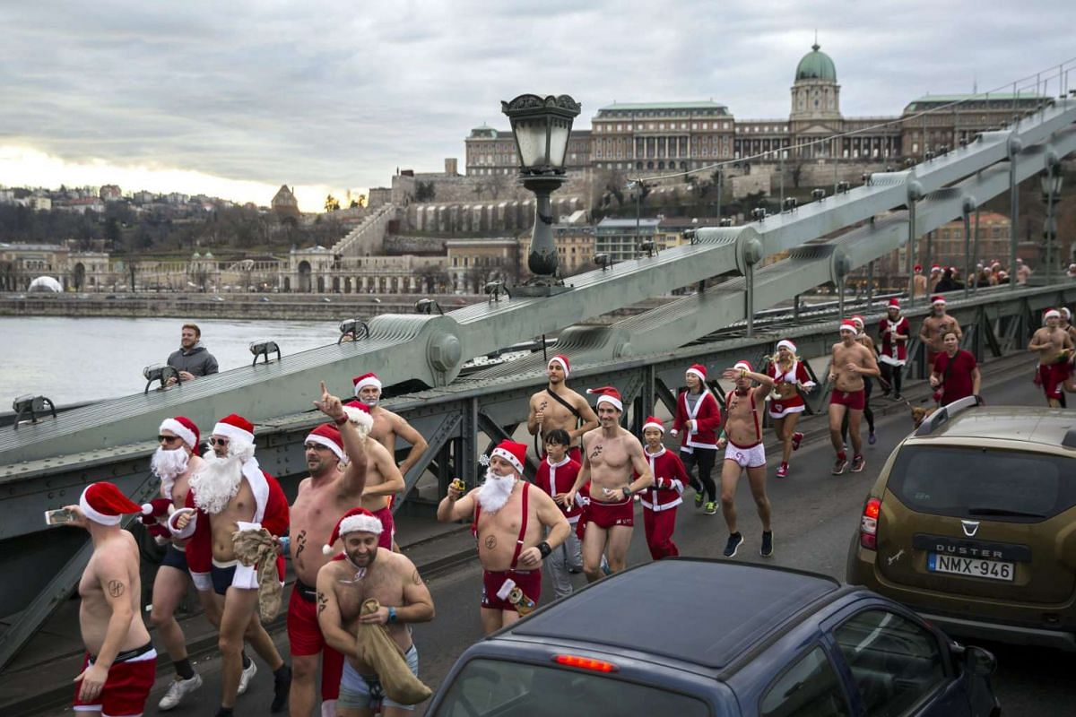 Thousands of Hungarians braved the cold for charity in the Great Santa Claus Run in Budapest on Dec 11, 2016, pairing Santa hats with swimming suits.