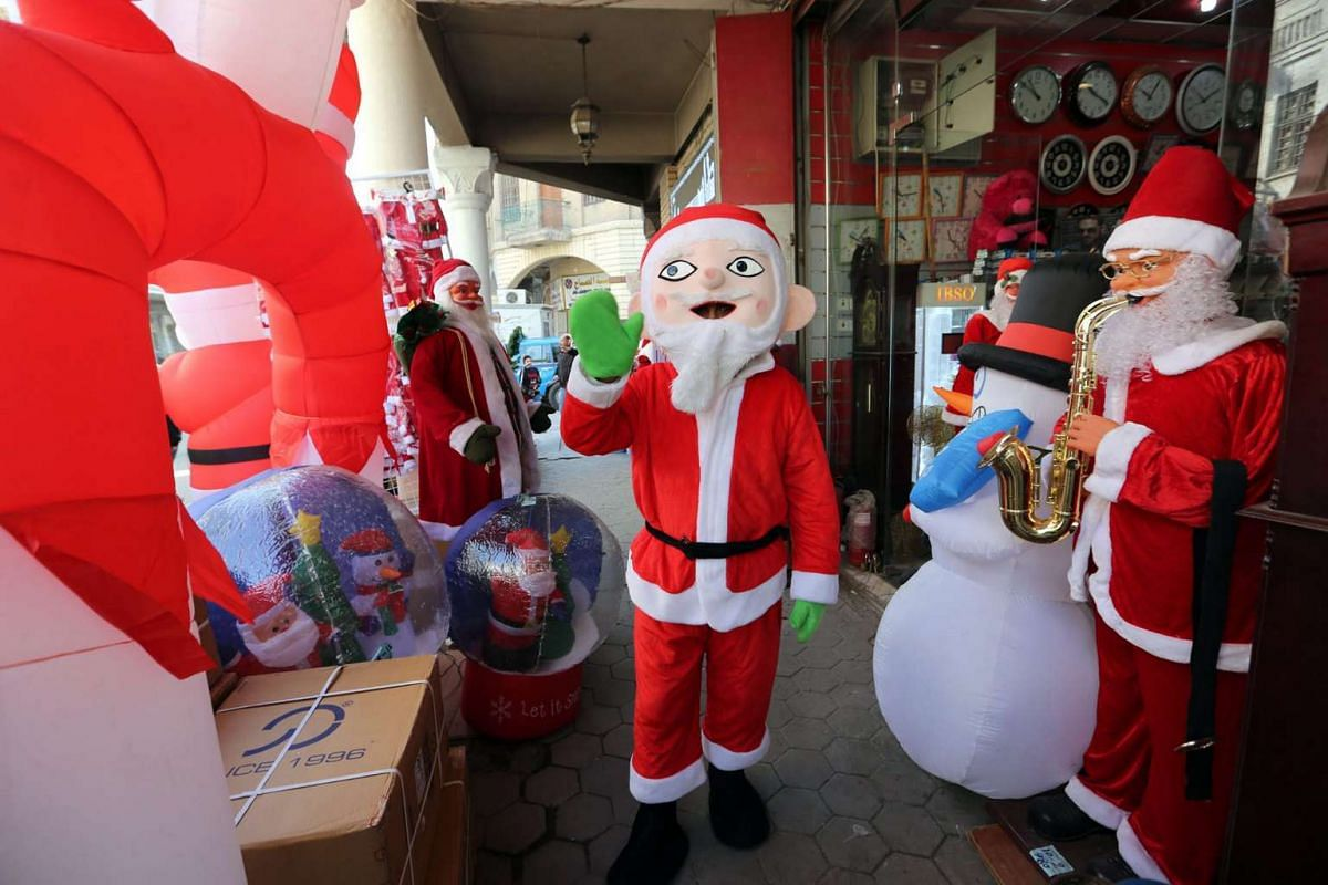 There may not be much snow in Iraq, but Santa Claus brings festive cheer all the same in Baghdad on Dec 14, 2016.