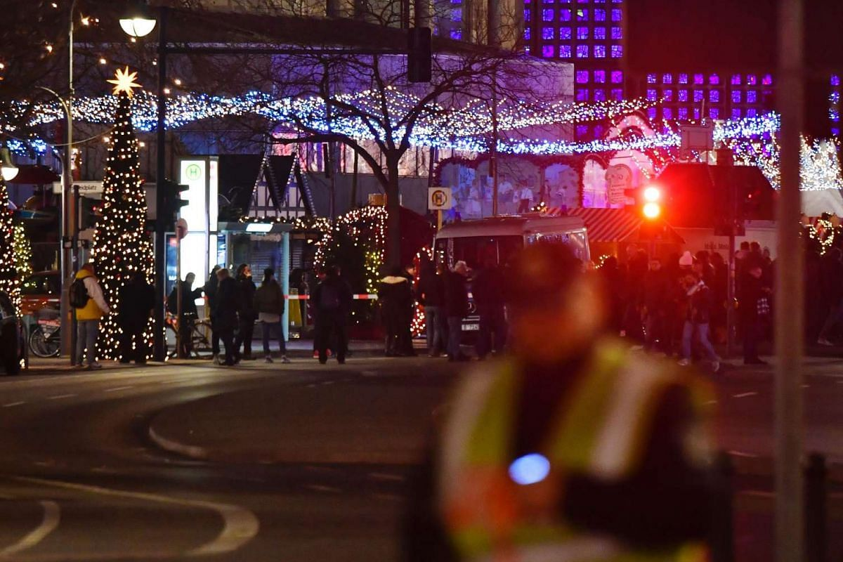 Bystanders gathering near the site of the crash. Berlin police said there were no indications of further dangerous situations in the area and have urged people to stay away from the scene.