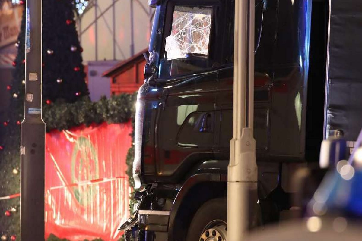 The truck had crashed into people gathered around the wooden huts serving mulled wine and sausages at the foot of the Kaiser Wilhelm memorial church in the heart of former West Berlin.