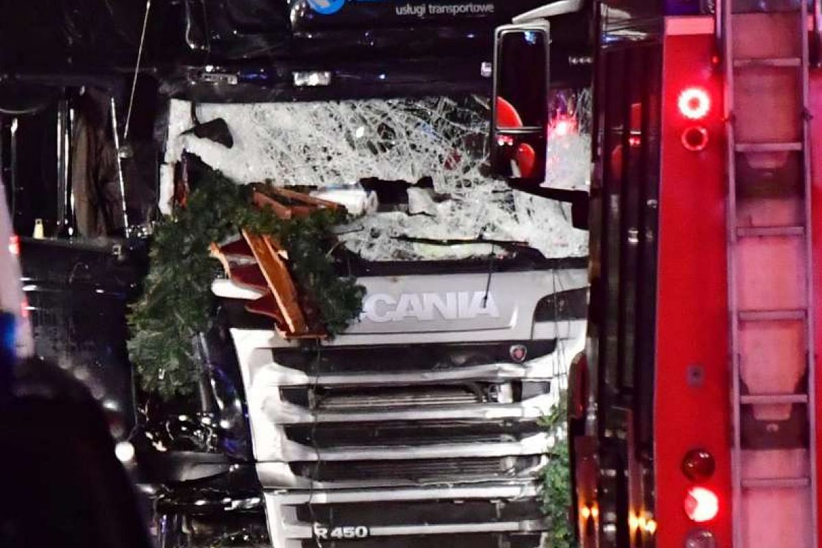 The broken front window of the truck that sped into the Christmas market.
