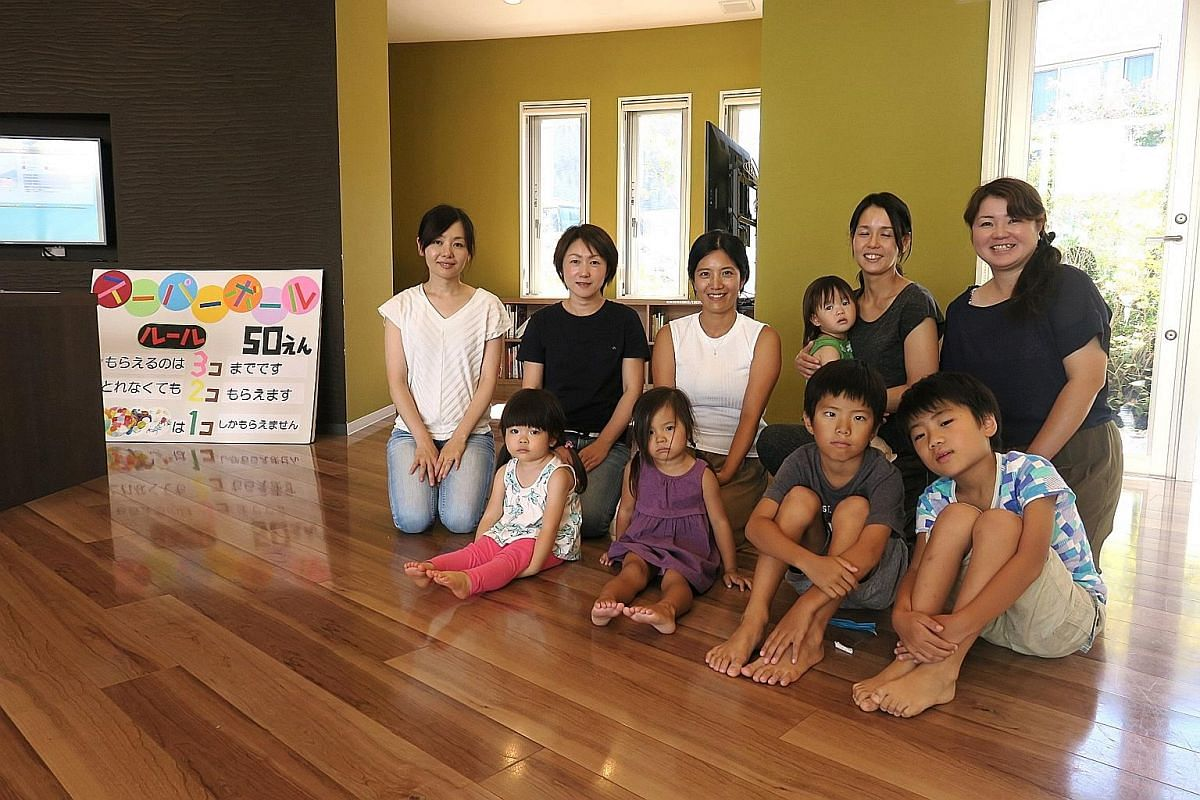 Housewives and their children gather once a week at the open-concept community centre where recreational activities are frequently conducted to develop a community spirit. They moved to the town from different parts of Japan and have since become goo
