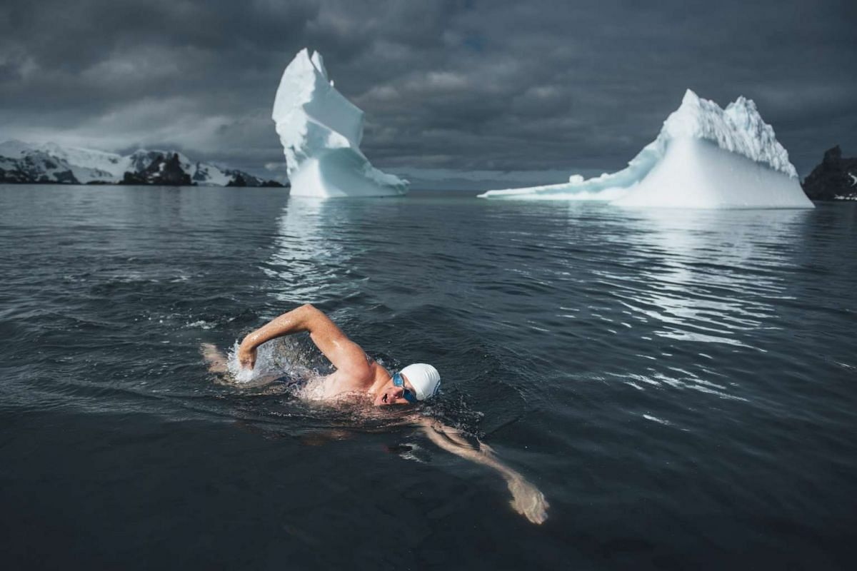 A handout photo dated December 13, 2016 and made available on December 21, 2016 shows British activist Lewis Pugh during his crossing through the waters of the Media Luna island, archipelago of the South Shetland, Antarctica, in a call for an ocean p