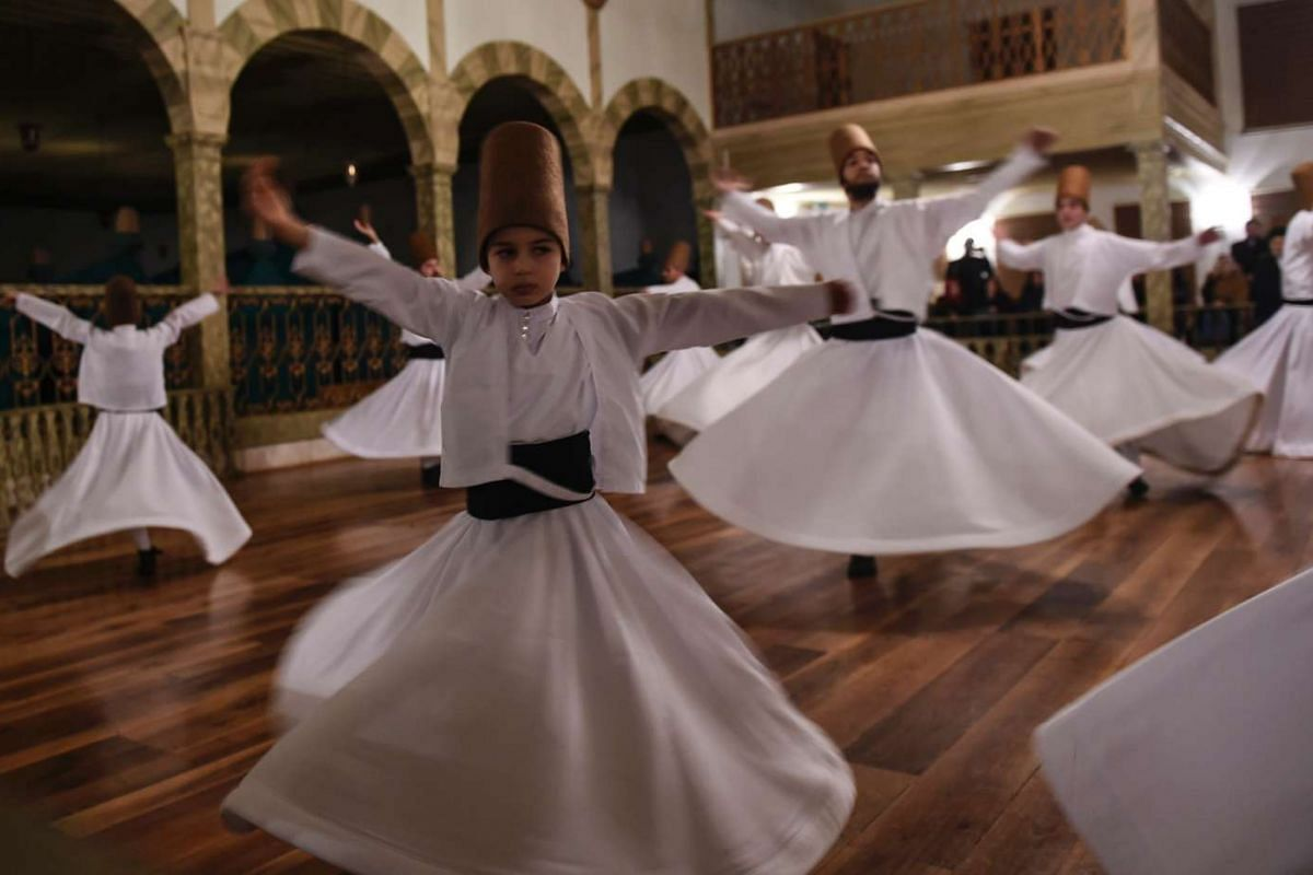 Whirling dervishes perform during a ceremony marking the anniversary of the death of Jelaleddin Mevlana Rumi, Sufi mystic, poet and founder of the sufism on December 21, 2016 at Yenikapi Mevlihanesi in Istanbul. PHOTO: AFP