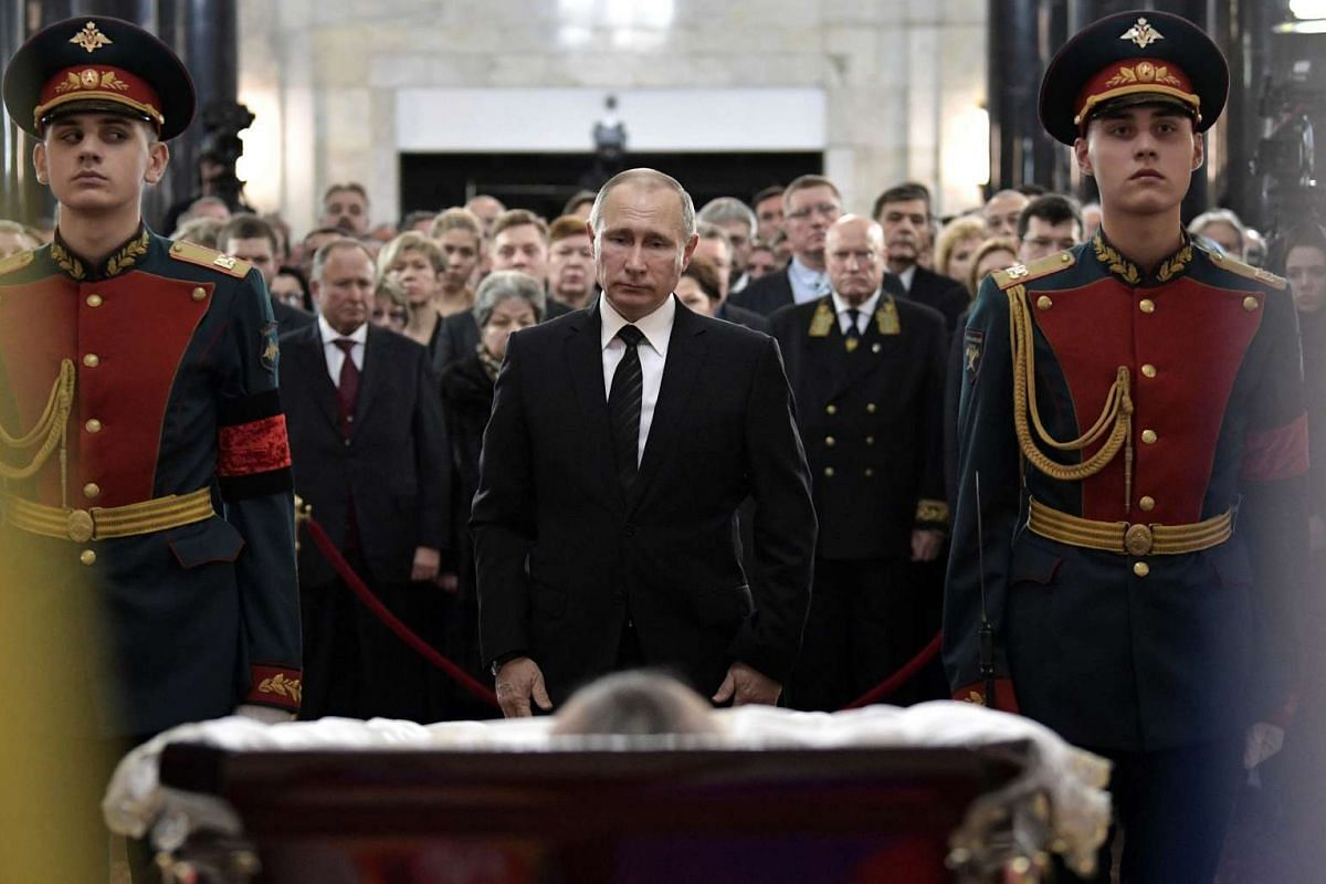 Russian President Vladimir Putin attends a memorial ceremony held for Russia's ambassador to Turkey Andrei Karlov, who was shot dead by an off-duty policeman while delivering a speech in an Ankara art gallery on December 19, in Moscow, Russia Decembe
