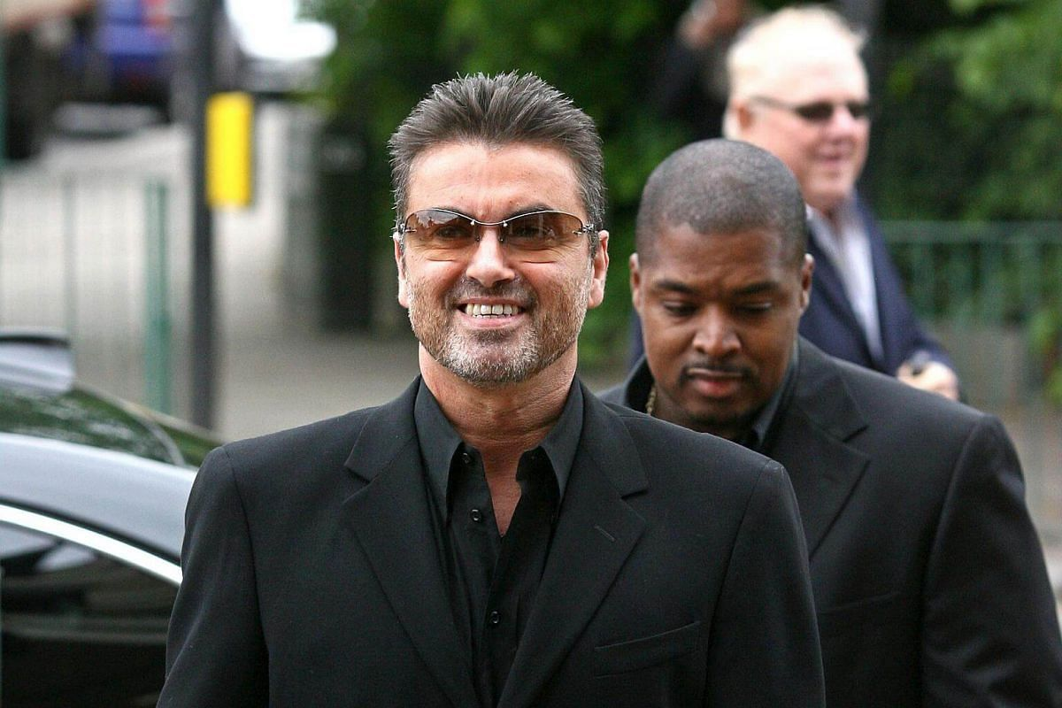 This photo taken on May 8, 2007, shows British pop star George Michael (left) arriving at Brent Magistrates Court in west London, as he faces charges of driving while unfit through drugs.