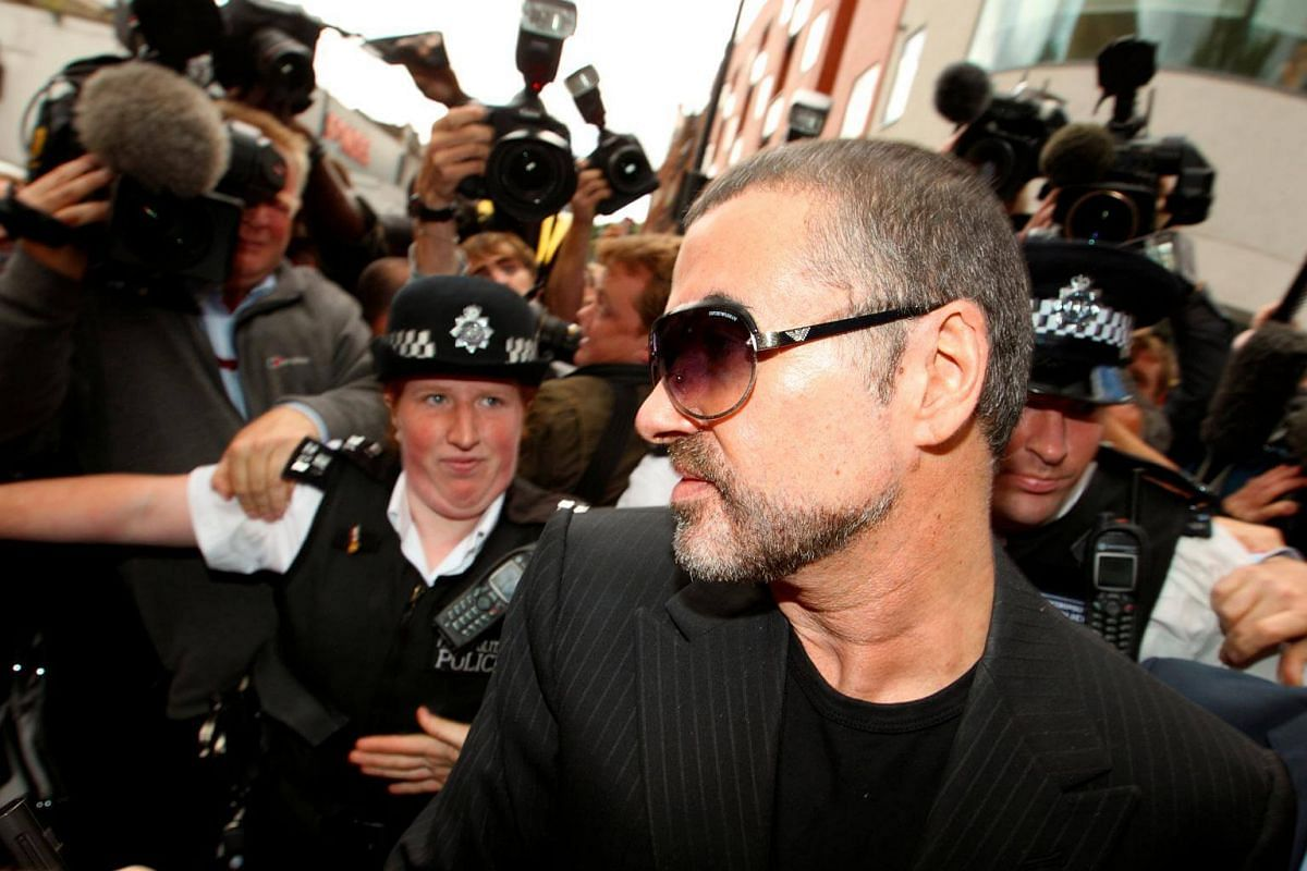 British singer George Michael is escorted out of Highbury Corner Magistrates Court in London, on Aug 24, 2010.
