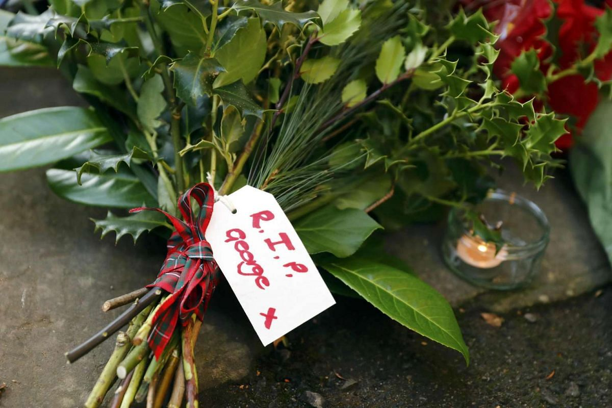 Tributes outside the house of singer George Michael, where he died on Christmas Day, in Goring, southern England, Britain on Dec 26, 2016.