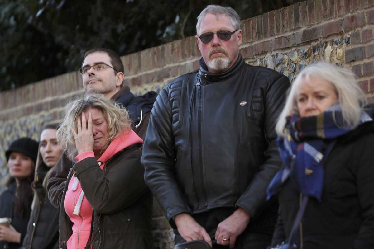People react outside the house of singer George Michael on Dec 26, 2016.
