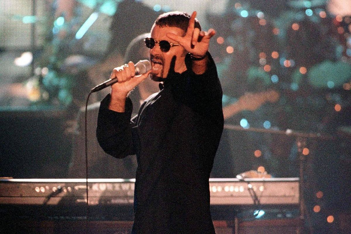 Singer George Michael performs Living For The City during the VH1 Honors Awards concert on April 10, 1997, in Los Angeles.