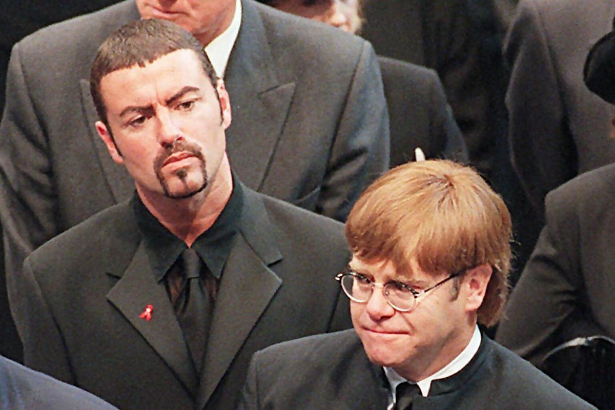 Pop stars George Michael (left) and Elton John leaving Westminster Abbey following the funeral service of Diana, Princess of Wales, on Sept 6, 1997.
