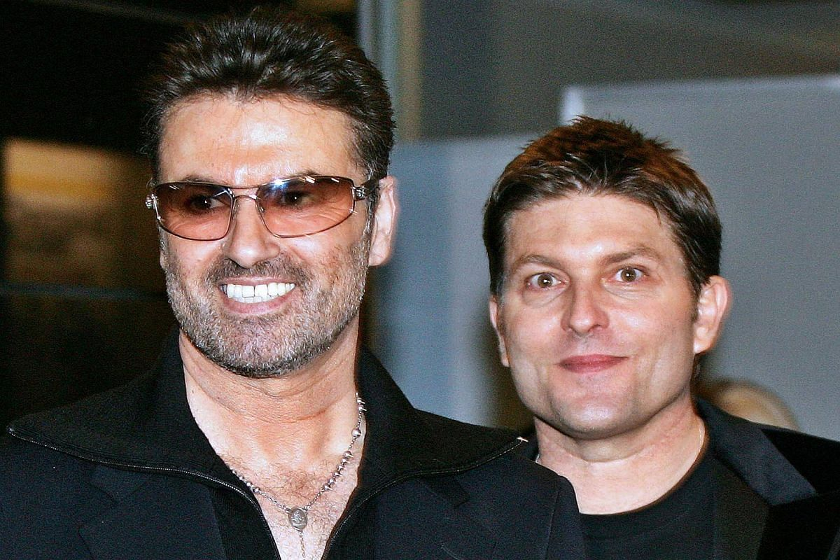 British pop star George Michael (left) with his partner Kenny Goss at a reception after the Japan premiere of his autobiographical movie George Michael, A Different Story in Tokyo on Dec 15, 2005.