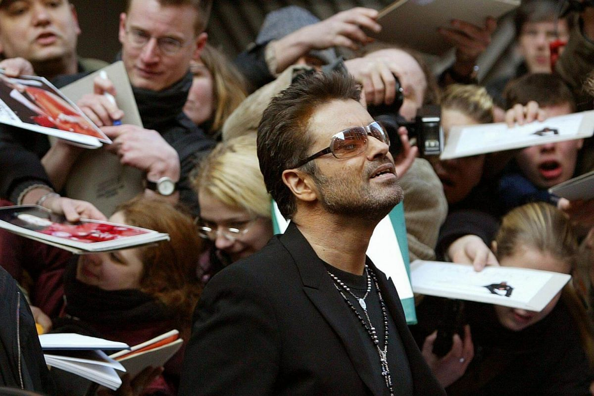 British singer and actor George Michael leaves a news conference for the film George Michael - A Different Story in Berlin on Feb 16, 2005.