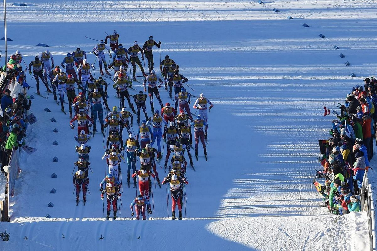 Skiers compete during the men's 20km Skiathlon competition of the 'Tour de Ski' FIS Cross Country World Cup on Jan 3, 2017 in Oberstdorf, southern Germany.
