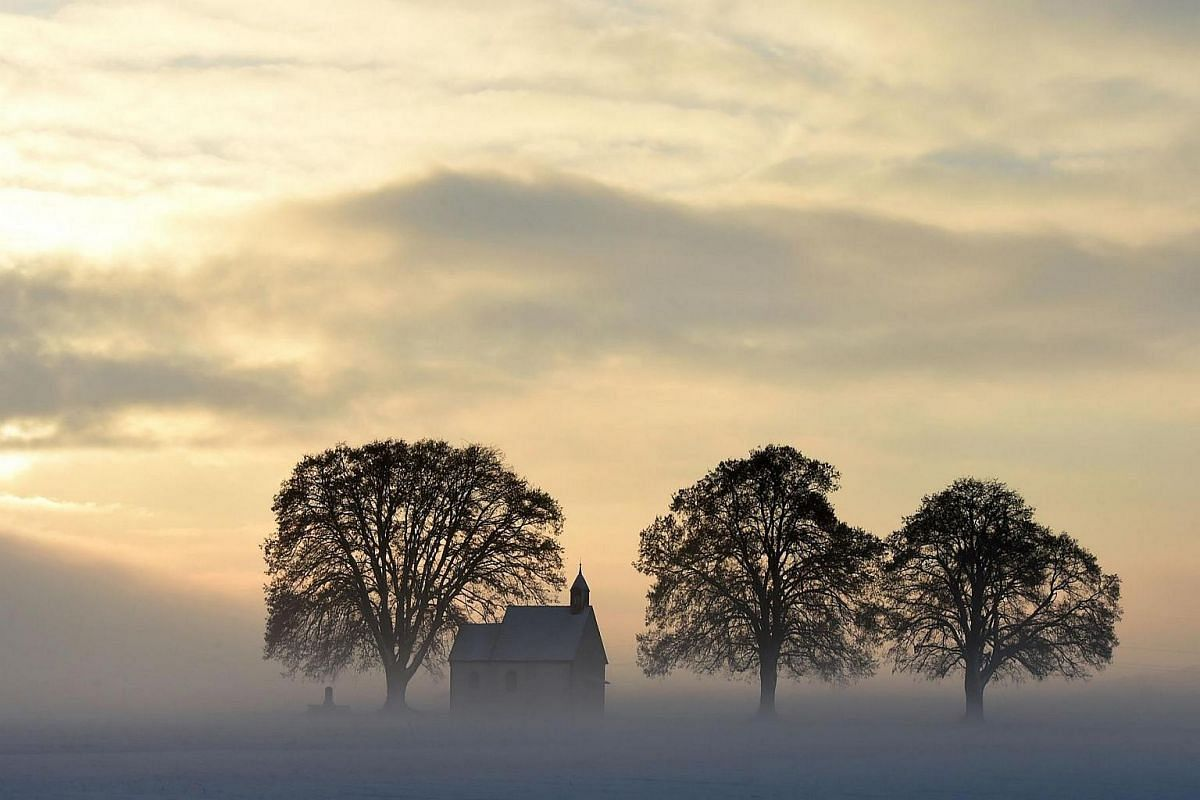Fog surrounds a small church not far from the small Bavarian village Apfeltrach near Landsberg, southern Germany.