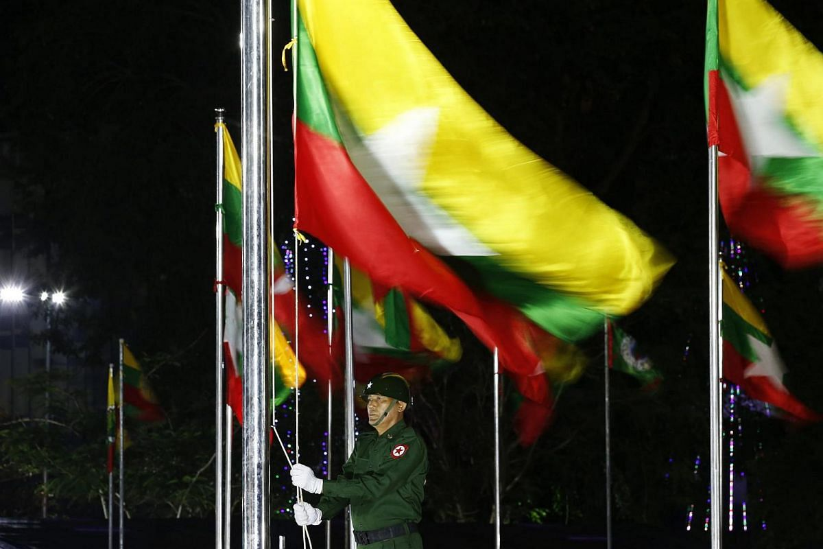 A soldier raises the Myanmar national flag during a military parade and flag-rising ceremony to mark the 69th Myanmar Independence Day in Yangon, Myanmar, on Jan 4, 2017.