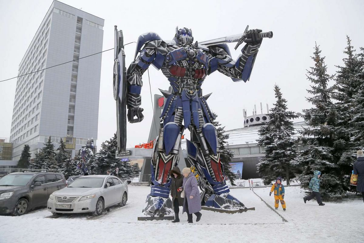 Visitors walk in front of an Optimus Prime figure from the Transformers movie series at the Revolt Of Machines Museum during the New Year holiday in Moscow, Russia on Jan 4, 2017.