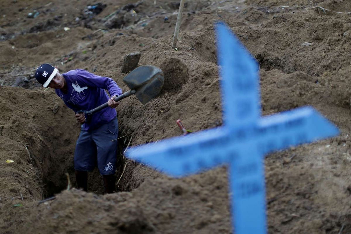 A graveyard worker digs a grave before the funeral of one of the inmates who died during a prison riot, at the cemetery of Taruma in Manaus, Brazil on Jan 4, 2017.