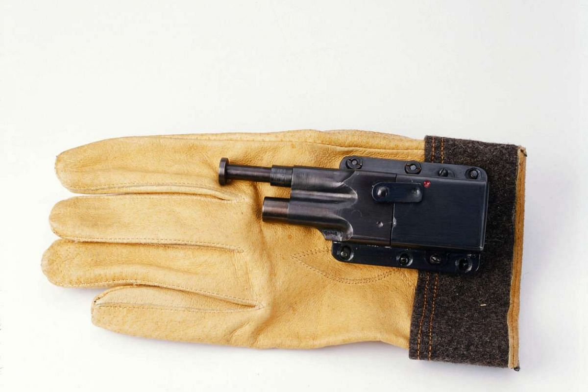 A handout photo of a glove gun, issued by the US Navy. To trigger the gun, the wearer had to push the plunger into an attacker's body.