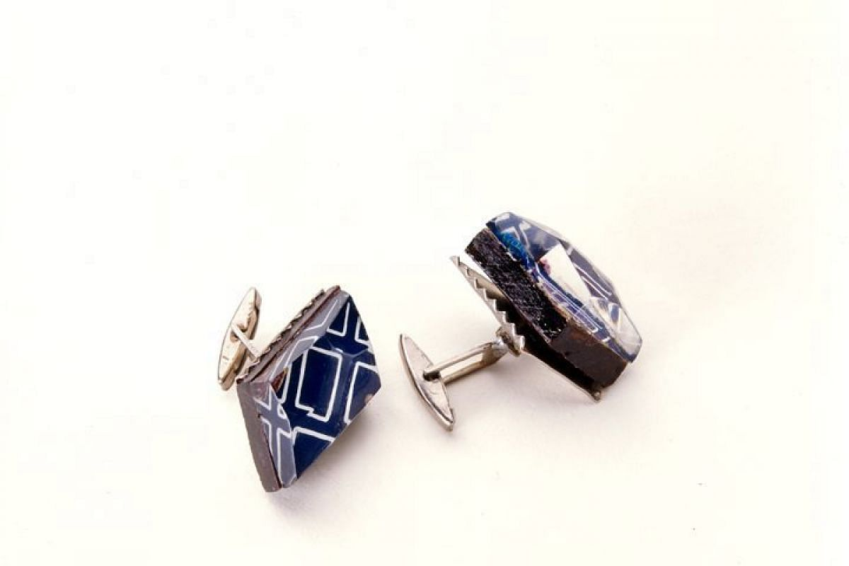 A handout photo of cuff links issued by the KGB in the 1950s. The hollowed base of these cufflinks could be used to smuggle microdot film across a border.