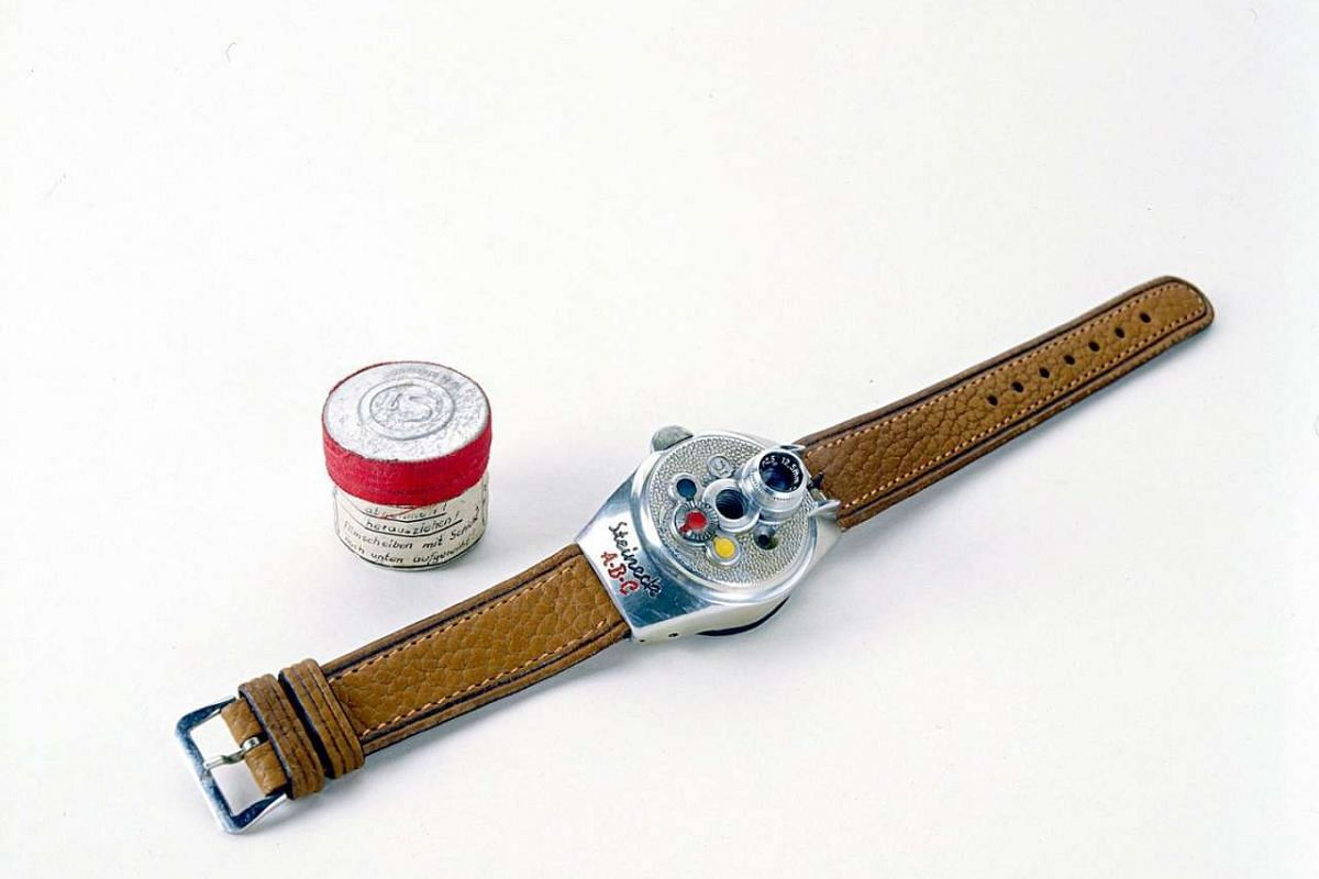 A handout photo of the Steineck watchcam, a product of post-World War II Germany. The camera allowed an agent to snap pictures while appearing to check the time. The film disk, about an inch across, could produce eight exposures.