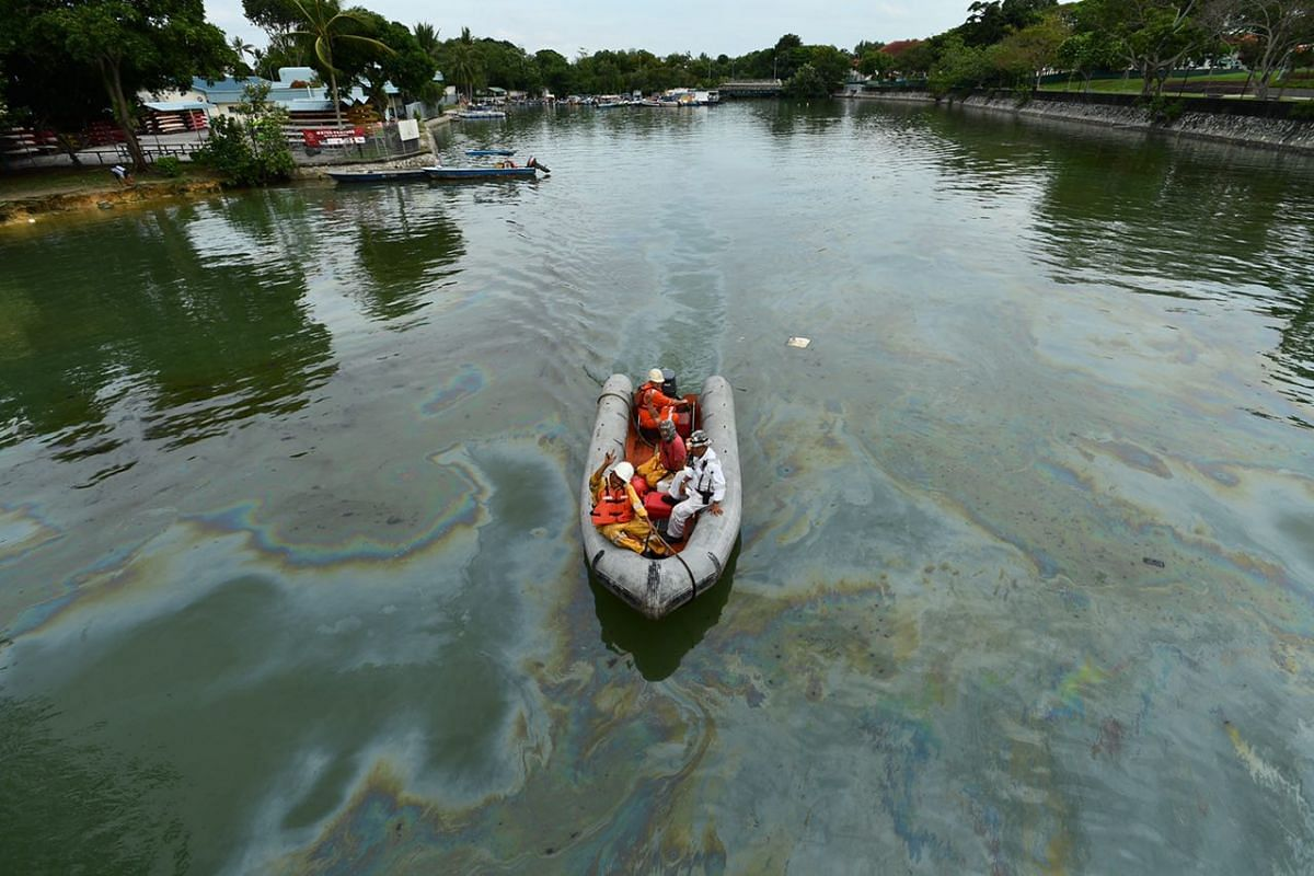 Patches of oil are seen in the waters at Changi Jetty on Jan 5, 2017.