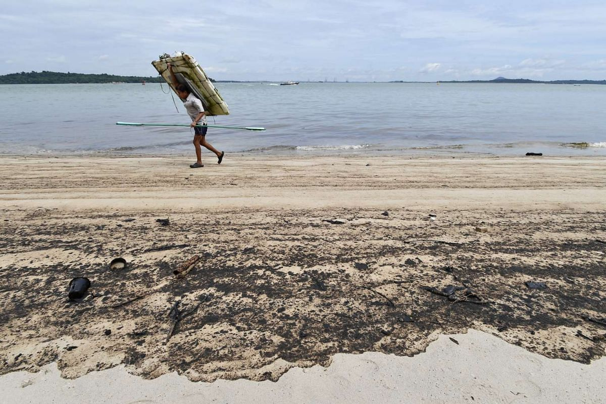 Oil stained sand along Changi Beach on Jan 5, 2017.