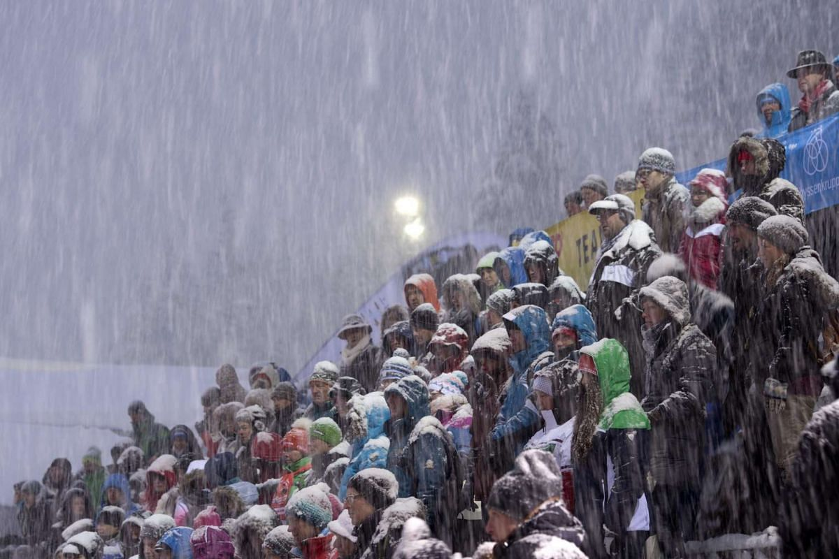 Spectators are seen in heavy snowfall during the victory ceremony of the Luge World Cup in Schoenau am Koenigssee, Germany, on Jan 5, 2017.
